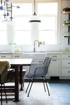 If open floor plans (literally) tore down walls, the latest trend takes things one step further: Bringing elements of the living and dining rooms right into the kitchen. Many of Ford's clients are skipping kitchen islands entirely, opting for a rustic wood table instead. Click through for more kitchen design tips from the best in the business.