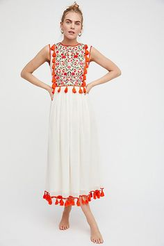 resort wear dress with red tassels and patterened top