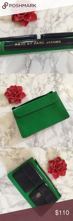 Marc by Marc Jacobs Pocket Clutch Handbag Leather Marc Jacobs Pocket Clutch Patented Leather. 10.5 inches by 6.5 Inches. Kelley Green and dark navy. Excellent condition. There are two dents that can be reformed due to storage. Marc By Marc Jacobs Bags Clutches & Wristlets