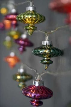 very cute idea for some transparent ornaments.    Vintage ornaments into lights