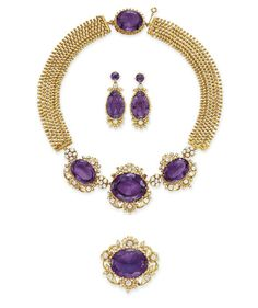 AN ANTIQUE SUITE OF AMETHYST, DIAMOND AND GOLD JEWELRY   Comprising a necklace, set at the front with three oval-cut amethysts, each within an old mine-cut diamond and seed pearl surround, to the textured gold band, joined by an amethyst clasp of similar design; a pair of ear pendants and a brooch en suite, mounted in gold, circa 1830, necklace 17 ins., in a fitted gray suede case