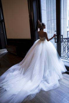 Melissa Gentile Fall 2015 couture bridal collection style # Luxembourg. Han beaded Swarovski crystal corset bodice. tulle wedding dress. couture bridal gown. tulle ball gown. high-fashion bridal couture. princess wedding dress. dramatic wedding dress. dream wedding dress. www.melissagentile.com