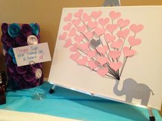 Baby Shower guest book alternative: elephant themed on stretched canvas. Filled with pink paper balloon hearts guest could sign. Created by LessThanThree Designs.  www.facebook.com/lessthanthreedesigns