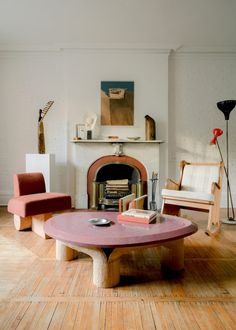 Collectible furniture with handcrafted details helps to complement the rustic features of this pre-war brownstone in the West Village, which interior designer Olivier Garcé turned into an art and design showroom during lockdown. Red Coffee Tables, Coffee Table With Stools, Stone Coffee Table, New York Office, New York Homes, West Village, Rustic Interiors, Side Chairs, Living Room Furniture
