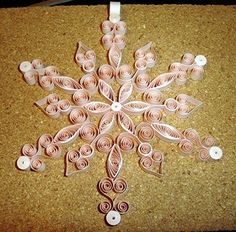 Quilled Snowflake ~ Free tutorial at http://www.naqg.org/FreePatterns/freepatternsmain.htm