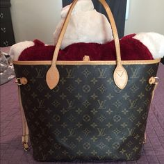 Louis Vuitton - Neverfall MM This Neverfall bag is in good condition there's no stains inside the bag, patina is beautiful, small white stains on the bottom of the bag. Bag does not come with box, receipt, nor dust bag. The bag is Authentic!. Louis Vuitton Bags Totes