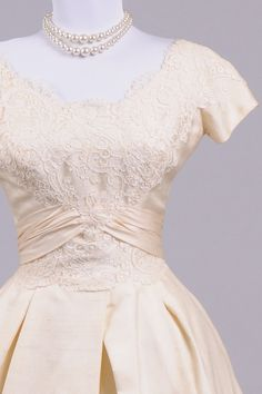 Designed in the 50's, by Jessica, this magnificent blush toned vintage wedding dress is done in a peau de soie silk over a satin faille and an additional lin...