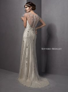 Vintage romantic satin and tulle sheath wedding dress, with delicate illusion lace cap-sleeves and illusion back. Evelina by Sottero and Midgley.
