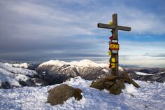on the summit - The wooden cross on top of the mountain that dominates the landscape below