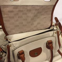 Large Michael Kors Margo Satchel Pre-Loved Auth Michael Kors Margo Leather Shoulder Satchel in Vanilla/off white/Luggage color. Great bag w/lots of compartments. Soft leather. It has been stored & just needs a good leather cleaning to look even better. See photos above for additional detail where it shows minor wear/scuffs on the bottom edges/front/back & MK gold logo. You can wear this bag as a cross body. This is a beauty & a classy bag! I have 2 of these & I'm keeping one for my own use…