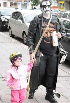 Bring Your Daughter To BDSM Tickle Chamber Day In This Picture: Photo of goth man and kid
