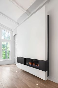 Modern Living Spaces // Design Detail U2013 A Modern Minimalist Fireplace  Surround By Thellend Fortin Architects