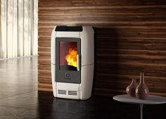 The subtly elegant Ambra pellet stove carries a clear hint of modern creativity. With its striking asymmetric body, Ambra measures 27 cm deep, so you Read Pellet Burner, Wood Pellet Stoves, Wood Burner, Pellet Fireplace Insert, Wood Burning Fireplace Inserts, Ice Fishing House, Wood Burning Heaters, Stove Heater, Cool Fire Pits