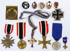 Lot 359: World War II German Service and Merit Awards; Including Veterans' service awards, war merit crosses, a Mother's cross and an Iron Cross