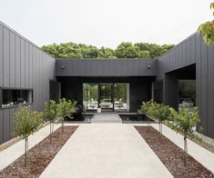 Striking yet simple, we see how this Waikanae home uses black cladding to set the scene for its minimalist interior style House Cladding, Exterior Cladding, Exterior Doors, Colonial Exterior, Cladding Panels, Exterior Signage, Shed Homes, Prefab Homes, Barn Homes