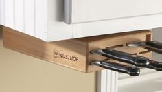 For Your Knives: Keep cutlery off your countertop with an under-cabinet storage block. - Six space-saving kitchen tricks via Kitchen Storage Solutions, Kitchen Organization, Organizing, Organization Ideas, Organized Kitchen, Used Cabinets, Kitchen Cabinets, Under Cabinet Knife Storage, Space Saving Kitchen