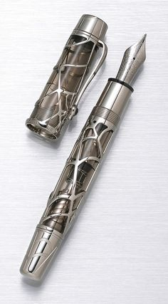 Lot66-Black Widow Skeleton MONTBLANC: Magical Black Widow Skeleton Limited Edition 88 Fountain Pen, One of the most sought after Montblanc pens, the Black Widow is encased by a web of white gold, featuring a filigree spider studded with black diamonds on the clip.... Platinum plated medium 18 K gold nib. Black lacquered presentation box with all original packaging and papers. Limited Edition: 54/88. Est. $18,000- $24,000