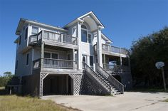 KATHY'S COTTAGE, #424 l Duck, NC - Outer Banks Vacation Rental Home l Oceanside home with six bedrooms (5 masters), media/game room with foosball and wet bar, private pool, hot tub and horseshoe pit. l www.CarolinaDesigns.com