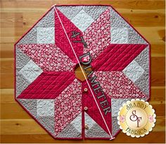 "Warm up your home this holiday season and spread the cheer with this darling Scandi Christmas Tree Skirt! Quilt measures at approximately 47"" in diameter. Pattern will include the instructions and diagram to complete the tree skirt. Add the Olfa Splash 45mm Rotary Cutter below to help with all of your precision cutting!"