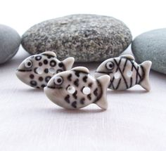 Here, fishy, fishy, fish.  Cool ceramic buttons for use in knitting/crafty things.