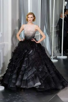 As many issues as I have with consumerism, particularly concerning the luxury goods industry, this is a work of art. Old Hollywood meets the 21st century. (Dior Haute Couture Spring 2012)