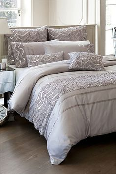Good bedding for a neutral bedroom. I love the texture this adds to the room!