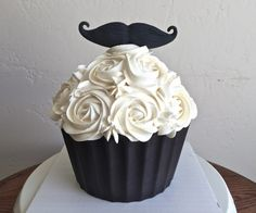 Mustache cupcake for a little boy's first smash cake. Mustache smash cake. Jumbo mustache cupcake -Created by Sweet Chariot Cakes in Fresno, CA