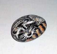 Raccoon hand painted Rock by aquietplace on Etsy