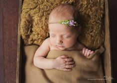 baby sleeping in box by Alicia Gould 5