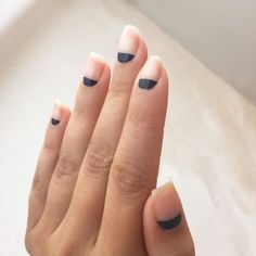 Matte meets minimal with this negative nail design. Try painting a half moon on each nail for a subtle and chic look.