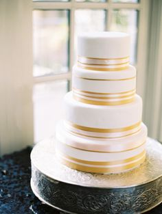 Gold striped cake: http://www.stylemepretty.com/2015/03/23/classic-ballroom-washington-dc-wedding/ | Photography: Abby Jiu - http://www.abbyjiu.com/