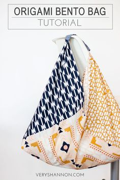 Origami Bento Fat Quarter Bag Tutorial // Arizona fabric by April Rhodes for Art Gallery Fabrics.This is a free sewing tutorial demonstrating how to sew the Origami Bento Bag sewn from three fat quarters by Very Shannon. Shannon used quilting cottonsI've Sewing Hacks, Sewing Tutorials, Sewing Tips, Sewing Ideas, Bag Tutorials, Sewing Crafts, Craft Tutorials, Triangle Bag, Origami Bag
