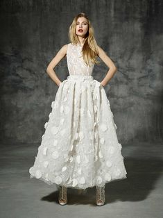 Casanova from Yolan Cris wedding dresses 2016 -Modern wedding dress with a boho folk style, ideal for wearing with boots, ankle-lenght skirt. Lace top and lovely girly skirt made of 3D flowers sewn by hand.- see the rest of the collection on www.onefabday.com