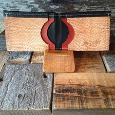 Beaver tail wallet that is bullet resistant, fire resistant, and RFID blocking