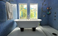 wood feet for tub  stained glass windows  blue tile