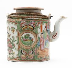 Teapot with cylindrical body and a curved metal spout. The two handles, also of metal are bound with string hooked through holes in lugs on the top of the pot. [...] | Horniman Museum and Gardens | CC0