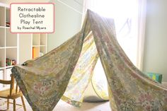 retractable clothes line fort for kids. always handy to have a clothes line in a preschool room!