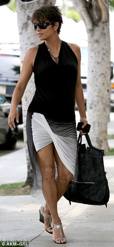 T-strap wedge heels and a black tank to her sultry ensemble