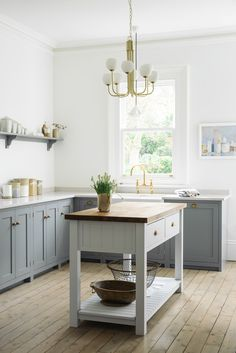 Stylish Freestanding Kitchen Islands & Carts - Thou Swell - Contemporary kitchen design with freestanding kitchen island cart and modern brass chandelier on Th - New Kitchen, Kitchen Interior, Kitchen Decor, Kitchen Ideas, Kitchen Grey, Interior Livingroom, Interior Plants, Kitchen Photos, Kitchen Modern