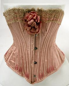 1904-05 French silk pink corset. In An Affair with Mr. Kennedy, Cassie St. Cloud answers the door wearing a pale blue version of this little number.