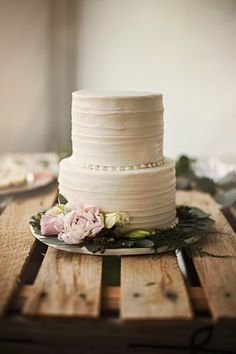 Simple wedding cake idea - white two-tiered buttercream-frosted cake {Relic Photographic}