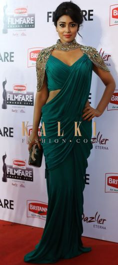 Must have Bollywood style! Find a style match to the celebrity look of your choice @ http://www.kalkifashion.com/sarees/saree-gowns.html