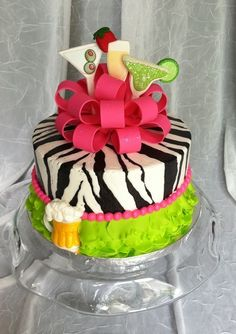 My friend's daughter wanted a cake that incorporated different kinds of drinks, zebra print and bright colors.