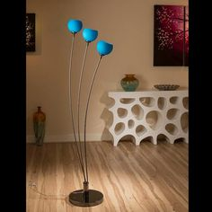 Stunning tulip standard floor light with blue glass ball shades.  A truly stunning item with 3 beautiful glass shades and heavy nickel chrome base.  Made by Europe's top lighting manufacturer, please do not confuse with cheap Asian copies.