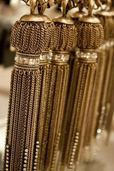 Shimmering gold tassels would add a brilliant elegance to a window treatment.