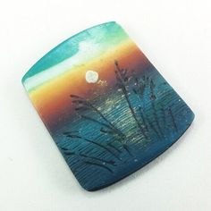 Handmade Polymer Clay 32 x 40mm Focal Bead  Pendant-Seascape-Sunset-Beach Themed-Blue-Yellow-Orange-PA 8626 by StudioStJames on Etsy