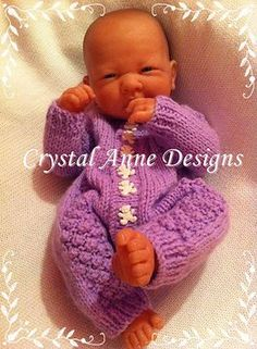 "DK for Lucy Ravelry: 14"" Baby Romper Set pattern by Crystal-Anne Smith"