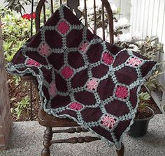Crochet yourself this gorgeous crochet afghan pattern. Use the pink and brown worsted weight yarn colors to make it pop.