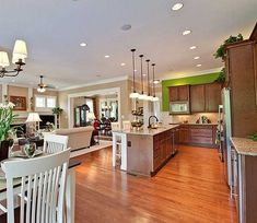 Kitchen View on Award winning Farmhouse plan Architectural Designs Plan W30018RT great pictures of open plan