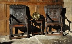 AN EXTREMELY RARE AND WONDERFUL PAIR OF CHARLES II CARVED OAK COMMEMORATIVE PANEL BACK OPEN ARMCHAIRS. NAMED AND DATED 1678, CHESHIRE / DERBYSHIRE .